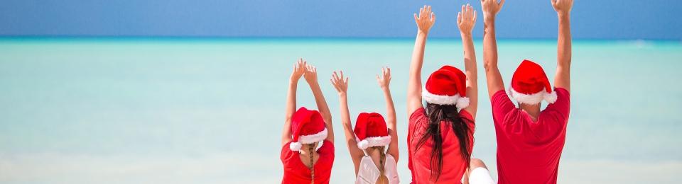 Family celebrating Christmas on the beach