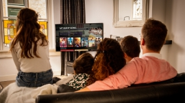 Family watching New Faith Network on their TV